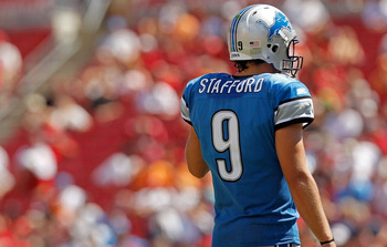 TAMPA, FL - SEPTEMBER 11:  Matthew Stafford #9 of the Detroit Lions waits for a play during the season opener against the Tampa Bay Buccaneers at Raymond James Stadium on September 11, 2011 in Tampa, Florida.  (Photo by Mike Ehrmann/Getty Images)