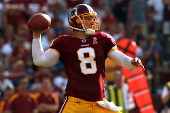 LANDOVER, MD - SEPTEMBER 11:  Quarterback  Rex Grossman #8 of the Washington Redskins throws the ball in the second quarter against the New York Giants at FedExField on September 11, 2011 in Landover, Maryland.  (Photo by Ronald Martinez/Getty Images)