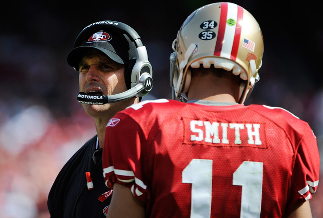 SAN FRANCISCO, CA - SEPTEMBER 11: Head coach Jim Harbaugh of the San Francisco 49ers talks with his quarterback Alex Smith #11 the while there's a timeout against the Seattle Seahawks in the third quarter of the season-opening game at Candlestick Park on