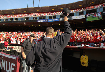 SAN FRANCISCO, CA - SEPTEMBER 11:  San Francisco 49ers head coach Jim Harbaugh waves his hat to the crowd after they beat the Seattle Seahawks in their season opener at Candlestick Park on September 11, 2011 in San Francisco, California.  (Photo by Ezra S