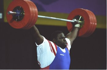 Mark Henry competes in weightlifting in the 1996 Summer Olympics.
