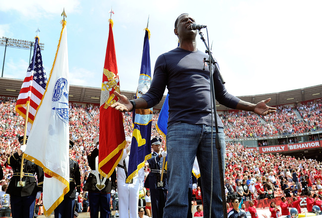 SAN FRANCISCO, CA - SEPTEMBER 11: Brian McKnight American song-writer and R&B singer sings the National Anthem before the season-opening game between the Seattle Seahawks and the San Francisco 49ers at Candlestick Park on September 11, 2011 in San Francis