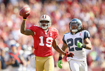 SAN FRANCISCO, CA - SEPTEMBER 11:   Ted Ginn #19 of the San Francisco 49ers outruns Earl Thomas #29 of the Seattle Seahawks on his way to scoring a touchdown on a kickoff return during their season opener at Candlestick Park on September 11, 2011 in San F