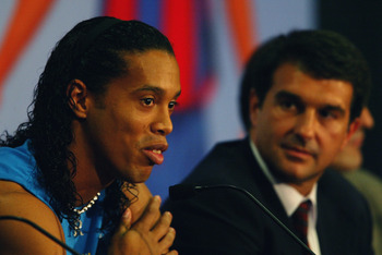BARCELONA - JULY 21:  Ronaldinho of Brazil with the president of Barcelona FC Joan Laporta talking to the press during the Barcelona FC Press Conference for the signing of new player Ronaldinho on July 21, 2003 at the Nou Camp in Barcelona, Spain. (Photo
