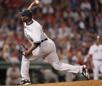 BOSTON, MA - AUGUST 07:  Rafael Soriano #29 of the New York Yankees delivers a pitch in the seventh inning against the Boston Red Sox on August 7, 2011 at Fenway Park in Boston, Massachusetts.  (Photo by Elsa/Getty Images)