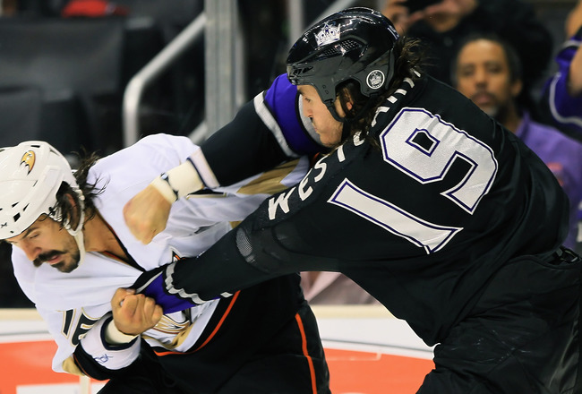 LOS ANGELES, CA - SEPTEMBER 28:  Kevin Westgarth #19 of the Los Angeles Kings throws a punch at George Parros #16 of the Anaheim Ducks in the second period at Staples Center on September 28, 2010 in Los Angeles, California.  (Photo by Jeff Gross/Getty Ima
