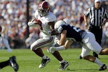 STATE COLLEGE, PA - SEPTEMBER 10:  Running back Trent Richardson #3 of the Alabama Crimson Tide eludes a tackle by Drew Astorino #28 of the Penn State Nittany Lions during the first half at Beaver Stadium on September 10, 2011 in State College, Pennsylvan