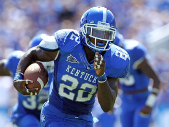 LEXINGTON, KY - SEPTEMBER 10: Danny Trevathan   #4 of the Kentucky Wildcats runs with the ball after intercepting a pass during the game against the Central Michigan Chippewas during the game at Commonwealth Stadium on September 10, 2011 in Lexington, Ken