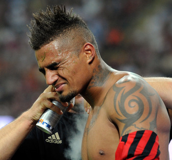 MILAN, ITALY - SEPTEMBER 09:  Kevin Prince Boateng of AC Milan receives treatment during the Serie A match between AC Milan and SS Lazio at Stadio Giuseppe Meazza on September 9, 2011 in Milan, Italy.  (Photo by Claudio Villa/Getty Images)