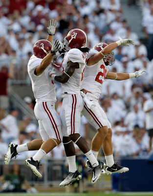 STATE COLLEGE, PA - SEPTEMBER 10: Dre Kirkpatrick #21 of the Alabama Crimson Tide celebrates with teammates Vinnie Sunseri #3 and Will Lowery #29 after causing a fumble against the Penn State Nittany Lions during the second half at Beaver Stadium on Septe