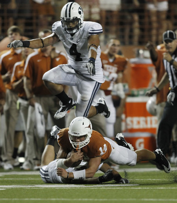 AUSTIN, TX Ð SEPTEMBER 10:  Backup quarterback David Ash #14 of the Texas Longhorns is brought down in the fourth quarter by defensive back Daniel Sorensen #9 of the BYU Cougars as BYU linebacker Uona Kaveinga #4 hurdles on September 10, 2011 at Darrell K