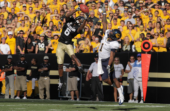 BOULDER, CO - SEPTEMBER 10:  Paul Richardson #6 of the Colorado Buffaloes is unable to make a reception against the defense of Steve Williams #1 of the California Golden Bears late in the fourth quarter at Folsom Field on September 10, 2011 in Boulder, Co
