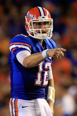 GAINESVILLE, FL - SEPTEMBER 10:  John Brantley #12 of the Florida Gators points during a game against the UAB Blazers at Ben Hill Griffin Stadium on September 10, 2011 in Gainesville, Florida.  (Photo by Sam Greenwood/Getty Images)