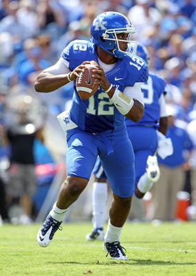 LEXINGTON, KY - SEPTEMBER 10:  Morgan Newton #12 of the Kentucky Wildcats looks to pass the ball  during the game against the Central Michigan Chippewas during the game at Commonwealth Stadium on September 10, 2011 in Lexington, Kentucky.  (Photo by Andy