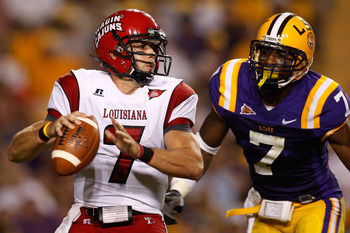 BATON ROUGE, LA - SEPTEMBER 19:  Quarterback Chris Masson #7 of the University of Louisiana-Lafatette Ragin' Cajuns looks to throw under pressure from Patrick Peterson #7 of the Louisiana State University Tigers at Tiger Stadium on September 19, 2009 in B
