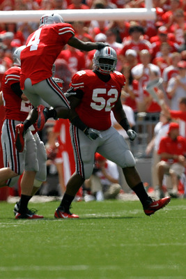 COLUMBUS, OH - SEPTEMBER 10:  Jaamal Berry #4 of the Ohio State Buckeyes congratulates Johnathan Hankins #52 of the Ohio State Buckeyes after sacking Austin Dantin #4 of the Toledo Rockets on September 10, 2011 at Ohio Stadium in Columbus, Ohio. (Photo by