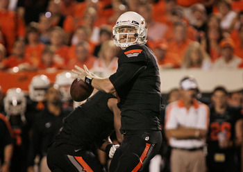STILLWATER, OK - SEPTEMBER 8:  Quarterback Brandon Weeden #3 of the Oklahoma State Cowboys prepares to throw during the second half against the Arizona Wildcats on September 8, 2011 at Boone Pickens Stadium in Stillwater, Oklahoma.  Oklahoma State defeate