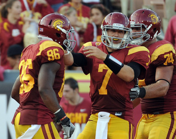 LOS ANGELES, CA - SEPTEMBER 10:  Matt Barkley #7 of the USC Trojans reacts to his touchdown pass to Wes Horton #96 for a 17-7 lead over the Utah Utes during the third quarter at Los Angeles Memorial Coliseum on September 10, 2011 in Los Angeles, Californi