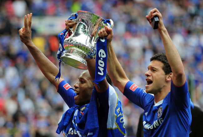 LONDON, ENGLAND - MAY 15:  Didier Drogba and Michael Ballack of Chelsea celebrate winning the FA Cup sponsored by E.ON Final match between Chelsea and Portsmouth at Wembley Stadium on May 15, 2010 in London, England.  (Photo by Shaun Botterill/Getty Image