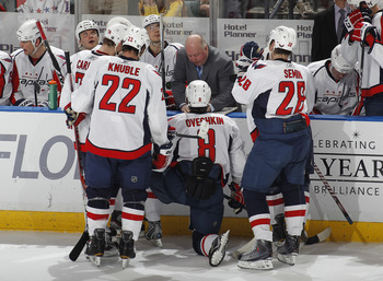 SUNRISE, FL - APRIL 9: Head coach Bruce Boudreau of the Washington Capitals talks to the team during a time out in the last minute of the game against the Florida Panthers on April 9, 2011 at the BankAtlantic Center in Sunrise, Florida. The Panthers defea