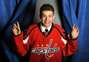 LOS ANGELES, CA - JUNE 25:  Evgeny Kuznetsov, drafted 26th overall by the Washington Capitals, poses on stage during the 2010 NHL Entry Draft at Staples Center on June 25, 2010 in Los Angeles, California.  (Photo by Harry How/Getty Images)