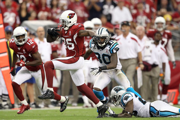 GLENDALE, AZ - SEPTEMBER 11:  Wide receiver Early Doucet #85 of the Arizona Cardinals runs with the football on a 70 yard touchdown reception against the Carolina Panthers during the NFL season opening game at the University of Phoenix Stadium on Septembe