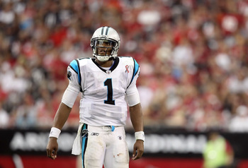 GLENDALE, AZ - SEPTEMBER 11:  Quarterback Cam Newton #1 of the Carolina Panthers walks off the field during the NFL season opening game against the Arizona Cardinals at the University of Phoenix Stadium on September 11, 2011 in Glendale, Arizona. The Cari