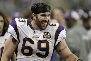 DETROIT, MI - JANUARY 02:  Jared Allen #69 of the Minnesota Vikings smiles on the bench after returning an interception for a touchdown while playing the Detroit Lions at Ford Field on January 2, 2011 in Detroit, Michigan. Detroit won the game 20-13.  (Ph
