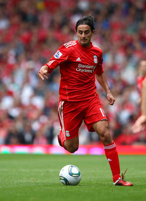 LIVERPOOL, ENGLAND - AUGUST 06:  Alberto Aquilani of Liverpool in action during the pre season friendly match between Liverpool and Valencia at Anfield on August 6, 2011 in Liverpool, England.  (Photo by Clive Brunskill/Getty Images)