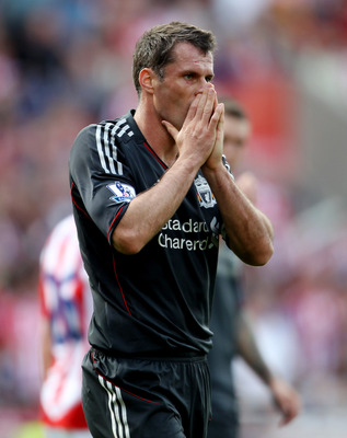 STOKE ON TRENT, ENGLAND - SEPTEMBER 10:  Jamie Carragher of Liverpool reacts after conceding a penalty during the Barclays Premier League match between Stoke City and Liverpool at Britannia Stadium on September 10, 2011 in Stoke on Trent, England.  (Photo