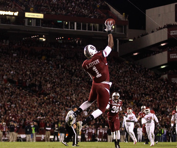 COLUMBIA, SC - NOVEMBER 06:  The defense of the Arkansas Razorbacks watch as Alshon Jeffery #1 of the South Carolina Gamecocks makes a catch during their game at Williams-Brice Stadium on November 6, 2010 in Columbia, South Carolina.  (Photo by Streeter L