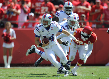 KANSAS CITY, MO - SEPTEMBER 11:  Quarterback Ryan Fitzpatrick #14 of the Buffalo Bills scrambles for yardage against the Kansas City Chiefs during the first quarter on September 11, 2011 at Arrowhead Stadium in Kansas City, Missouri.  (Photo by Peter Aike