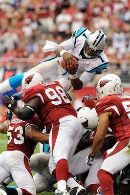 GLENDALE, AZ - SEPTEMBER 11:  Quarterback Cam Newton #1 of the Carolina Panthers dives into the end zone over the top of the pile against the Arizona Cardinals in the NFL season opening game at the University of Phoenix Stadium on September 11, 2011 in Gl