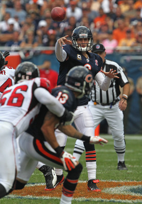 CHICAGO, IL - SEPTEMBER 11: Jay Cutler #6 of the Chicago Bears throiws a pass to teammate Johnny Knox who is held by Sean Weatherspoon #56 of the Atlanta Falcons at Soldier Field on September 11, 2011 in Chicago, Illinois. The Bears defeated the Falcons 3