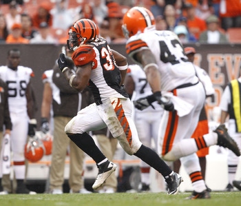 CLEVELAND, OH - SEPTEMBER 11:  Halfback Cedric Benson #32 of the Cincinnati Bengals scores a touchdown as he is chased by defensive back T.J. Ward #43 of the Cleveland Browns during the season opener  at Cleveland Browns Stadium on September 11, 2011 in C