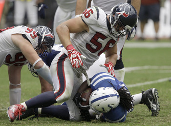 HOUSTON, TX - SEPTEMBER 11: Linebacker Brian Cushing #56 of the Houston Texans looks down on running back Joseph Addai #29 of the Indianapolis Colts on September 11, 2011 at Reliant Stadium in Houston, Texas. Texans won 34 to 7.(Photo by Thomas B. Shea/Ge