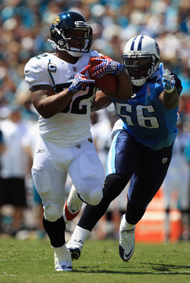 JACKSONVILLE, FL - SEPTEMBER 11:  Maurice Jones-Drew #32 of the Jacksonville Jaguars runs for a touchdown during their season opener against Akeem Ayers #56 of the Tennessee Titans at EverBank Field on September 11, 2011 in Jacksonville, Florida.  (Photo