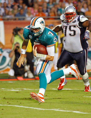 MIAMI GARDENS, FL - SEPTEMBER 12:  Chad Henne #7 of the Miami Dolphins rushes for a touchdown during a game against the New England Patriots at Sun Life Stadium on September 12, 2011 in Miami Gardens, Florida.  (Photo by Mike Ehrmann/Getty Images)