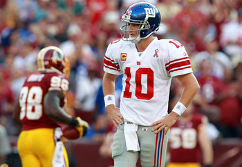 LANDOVER, MD - SEPTEMBER 11:   Eli Manning #10 of the New York Giants walks off the field during the season opener against the Washington Redskins at FedExField on September 11, 2011 in Landover, Maryland.  (Photo by Ronald Martinez/Getty Images)