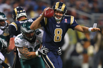 ST. LOUIS - SEPTEMBER 11: Sam Bradford #8 of the St. Louis Rams is sacked by Jason Babin #93 of the Philadelphia Eagles at the Edward Jones Dome on September 11, 2011 in St. Louis, Missouri. The Eagles beat the Rams 31-13. (Photo by Dilip Vishwanat/Getty