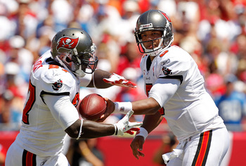 TAMPA, FL - SEPTEMBER 11:  Josh Freeman #5 of the Tampa Bay Buccaneers hands off to LeGarrette Blount #27 during the season opener against the Detroit Lions at Raymond James Stadium on September 11, 2011 in Tampa, Florida.  (Photo by Mike Ehrmann/Getty Im
