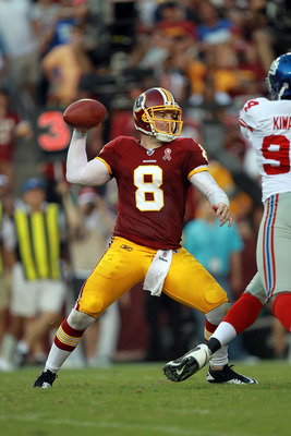 LANDOVER, MD - SEPTEMBER 11:   Rex Grossman #8 of the Washington Redskins throws the ball against the New York Giants during the season opener at FedExField on September 11, 2011 in Landover, Maryland.  (Photo by Ronald Martinez/Getty Images)