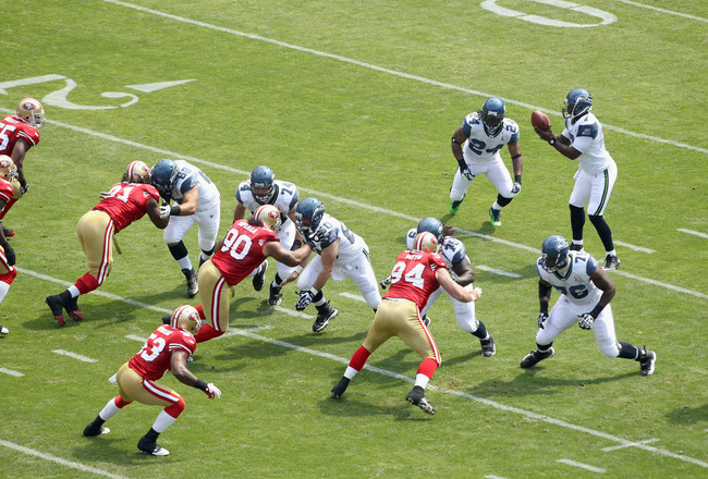 SAN FRANCISCO, CA - SEPTEMBER 11:  Tarvaris Jackson #7 of the Seattle Seahawks lines up his team against the San Francisco 49ers during their season opener at Candlestick Park on September 11, 2011 in San Francisco, California.  (Photo by Ezra Shaw/Getty