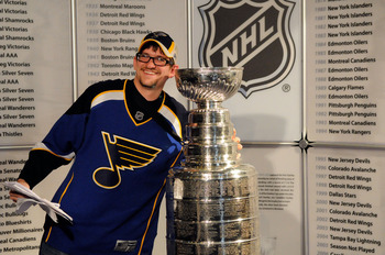 ST PAUL, MN - JUNE 24:  A fan poses with the Stanley Cup before the NHL draft during day one of the 2011 NHL Entry Draft at Xcel Energy Center on June 24, 2011 in St Paul, Minnesota.  (Photo by Hannah Foslien/Getty Images)