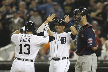 DETROIT - SEPTEMBER 09:  Alex Avila #13 of the Detroit Tigers hits a three-run home run in the second inning scoring Miguel Cabrera #24 and Victor Martinez #41 during the game against the Minnesota Twins at Comerica Park on September 9, 2011 in Detroit, M
