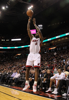 MIAMI, FL - DECEMBER 15: LeBron James #6 of the Miami Heat shoots a jump shot during a game against the Cleveland Cavaliers at American Airlines Arena on December 15, 2010 in Miami, Florida. NOTE TO USER: User expressly acknowledges and agrees that, by do