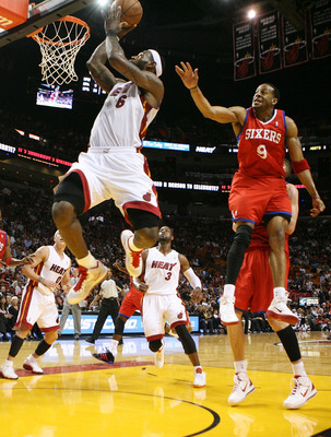 MIAMI, FL - MARCH 25:  LeBron James #6 of the Miami Heat dunks agains Guard Andre Iguodala #9 of the Philadelphia Sixers at American Airlines Arena on March 25, 2011 in Miami, Florida. NOTE TO USER: User expressly acknowledges and agrees that, by download