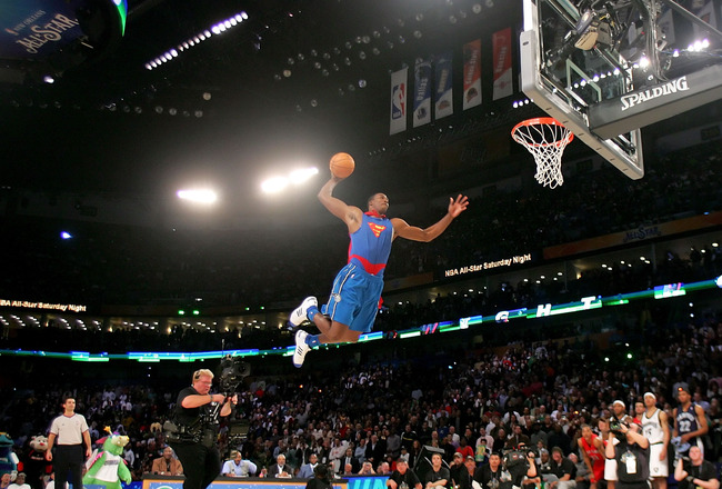 NEW ORLEANS - FEBRUARY 16:  Dwight Howard of the Orlando Magic completes a dunk in the Sprite Slam Dunk Contest, part of 2008 NBA All-Star Weekend at the New Orleans Arena on February 16, 2008 in New Orleans, Louisiana.  NOTE TO USER: User expressly ackno