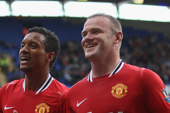 BOLTON, ENGLAND - SEPTEMBER 10: Wayne Rooney (R) of Manchester United celebrates scoring his sides third goal alongside Nani (L) during the Barclays Premier League at the Reebok Stadium on September 10, 2011 in Bolton, England.  (Photo by Michael Steele/G