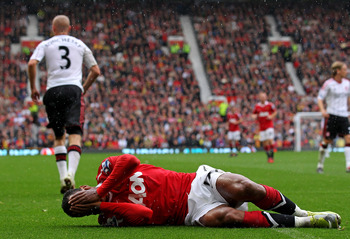 MANCHESTER, ENGLAND - SEPTEMBER 19:  Nani of Manchester United reacts following a challenge by Paul Konchesky of Liverpool during the Barclays Premier League match between Manchester United and Liverpool at Old Trafford on September 19, 2010 in Manchester